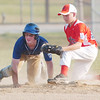 WARREN DILLAWAY / Star Beacon<br /> MIKI SHUTTLEWORTH (right) of Geneva United tags Madison's Jake Derus out at second base during Junior League All Star action at Madison Friday night.