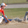 WARREN DILLAWAY / Star Beacon<br /> BRENT BELL (left) of Geneva United prepares to apply a tag as Madison's Wesley Bober slides into third during Junior All Star action at Madison Friday evening.