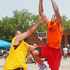 WARREN DILLAWAY / Star Beacon<br /> GIOVANTE ROSE of the T Cats (right) drives to the basket with Curtis Turner (left) of Steve's Car Care defending Saturday during the West Side Shoot Out at G.O. Ministries in Ashtabula.