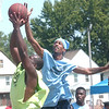 WARREN DILLAWAY / Star Beacon<br /> ANTHONY HARGROVE (back in air) leaps for the block of a shot by Jamal Holley of Chic's Bar during the West Side Shootout at G.O. Ministries in AShtabula Saturday.