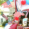 WARREN DILLAWAY / Star Beacon<br /> AMERICAN FLAGS brightened up The Heriage Girl Scout float Saturday at the Conneaut Fourth of July Festival parade.