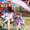 WARREN DILLAWAY / Star Beacon<br /> AMBER REITZ and her daughter Delaney, 5, both of Oklahoma, try to stay cool while waiting for the Conneaut Fourth of July Festival Parade to start Saturday afternoon.