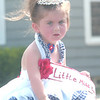 WARREN DILLAWAY / Star Beacon<br /> APPLEENA IMBROGNO, Little Miss Firecracker, rides in the Conneaut Fourth of July Festival parade Saturday.