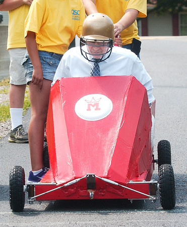 WARREN DILLAWAY / Star Beacon<br /> JOE DONATONE, superintendent of the Ashtabula Area City Schools, prepares to race a wooden car Thursday morning during an After Schools Discover program at Lakeside High School.