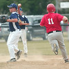WARREN DILLAWAY / Star Beacon<br /> NATHAN PAPE (with ball) of the Conneaut Major League All Stars forces out Perry's Donnie Waters Friday night at Skippon Park.
