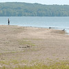 WARREN DILLAWAY / Star Beacon<br /> LOW WATER levels have created new land masses along Pymatuning Lake. A boy enjoys fishing along an area that is usually covered with water.