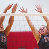 WARREN DILLAWAY / Star Beacon<br /> KIRSTIE OTTO (17) and Geneva teammate Natalie Thomas leap for a block Monday evening during a home match with West Geauga.