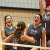 WARREN DILLAWAY / Star Beacon<br /> GENEVA TEAMMATES  Allie Penna (3), Christie Cash (15), Chelsea Scafuro (27) and Emily Ball (32) celebrate after a point Monday evening during a home match with West Geauga.