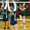 WARREN DILLAWAY / Star Beacon<br /> CHRISTIE CASH (15) of Geneva spikes the ball as West Geauga's Michelle Hanz-Pick (21) and Meghan Dayringer (34) leap for a block Monday night at Geneva.