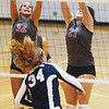 WARREN DILLAWAY / Star Beacon<br /> EMILY BALL (32) and Geneva teammate Chelsea Scafuro (21) leap for a block of a West Geauga spike by Meghan Dayringer Monday night at Geneva.