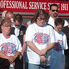 WARREN DILLAWAY / Star Beacon<br /> PARTICIPANTS IN the Freedom Walk pray during a stop at the Ashtabula Fire Department. The event was held to commemorate the lives lost during the terrorist attacks on Sept. 11, 2001.