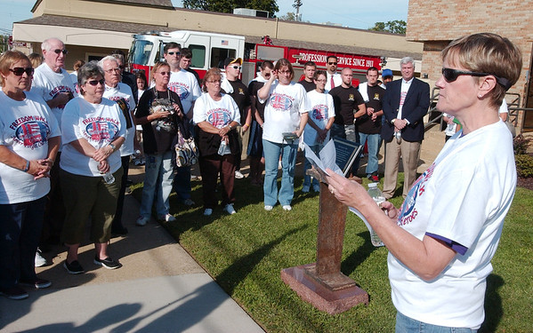 WARREN DILLAWAY / Star Beacon<br /> REV. CHRIS Bell of Ashtabula First United Methodist Church prays in front of the Ashtabula Fire Department during Freedom Walk Tuesday afternoon. The event was held to remember those who lost their lives during the Sept. 11, 2001, terrorist attacks.