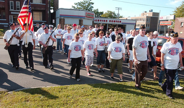 WARREN DILLAWAY / Star Beacon<br /> PARTICIPANTS IN the Freedom Walk gather on the front lawn of the Ashtabula Fire Department Tuesday afternoon in Ashtabula. The event was held to commemorate the lives lost during the terrorist attacks on Sept. 11, 2001.