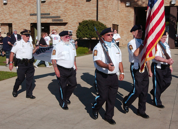 WARREN DILLAWAY / Star Beacon<br /> A MILITARY Honor Guard leads the Freedom Walk Tuesday afternoon in Ashtabula. The event was held to commemorate the lives lost during the terrorist attacks on Sept. 11, 2001.