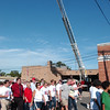 WARREN DILLAWAY / Star Beacon<br /> PARTICIPANTS IN the Freedom Walk  move under a flag hung from an Ashtabula Ladder Truck Tuesday afternoon in at the Ashtabula Fire Department. The event was held to commemorate the lives lost during the terrorist attacks on Sept. 11, 2001.