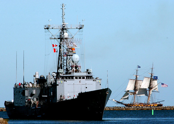 WARREN DILLAWAY / Star Beacon<br /> THE RE-CONSTRUCTED Flagship Niagara cruises outside Ashtabula Harbor Tuesday morning as the USS DeWert (FFG-45)  leaves Ashtabula Harbor on the way to War of 1812 festivities in Buffalo.