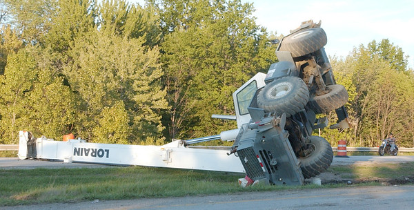 WARREN DILLAWAY / Star Beacon<br /> A CRANE lies on it's side Tuesday evening following a Tuesday afternoon incident on Route 11 north of Route 20 before the State Road overpass. Ashtabula firefighters responded to the incident but were not available to comment Tuesday night. A dispatcher said there were no injuries.