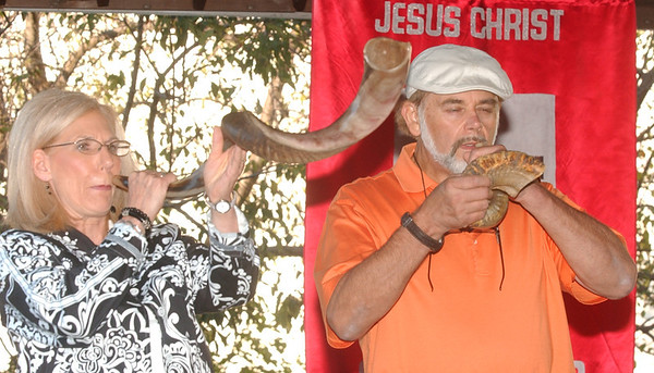 WARREN DILLAWAY / Star Beacon<br /> DONNA KUME (left) blows a  Shofar and John Kume blows a ram's horn to open the Cry Out America Prayer Service/Slash Memorial in Conneaut Tuesday night.