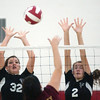WARREN DILLAWAY / Star Beacon<br /> LEE ANN FARR (32) and Jefferson teammate Bailey Beckwith leap for a block of a Liberty spike Thursday at Jefferson.