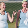 WARREN DILLAWAY / Star Beacon<br /> ASHLEY GRAN of Lakeside (right) enjoys a laugh with first doubles partner Courtney Smith  Thursday during a first doubles home match with Jefferson.