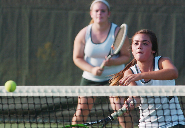 WARREN DILLAWAY / Star Beacon<br /> LEAH BRADY (right) of Lakeside lunges for the ball with second doubles teammate Emily Simpson waiting for a return Thursday during a home match with Jefferson.