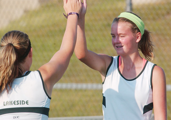 WARREN DILLAWAY / Star Beacon<br /> ASHLEY GRAN of Lakeside (right) high fives first doubles partner Courtney Smith  Thursday during a first doubles home match with Jefferson.