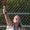 WARREN DILLAWAY / Star Beacon<br /> COURTNEY SMITH of Lakeside serves  Thursday during a first doubles home match with Jefferson.