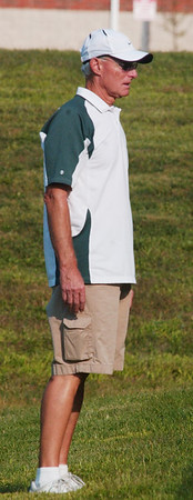 WARREN DILLAWAY / Star Beacon<br /> BOB WALTERS, Lakeside tennis coach watches the action Thursday during a home match with Jefferson.