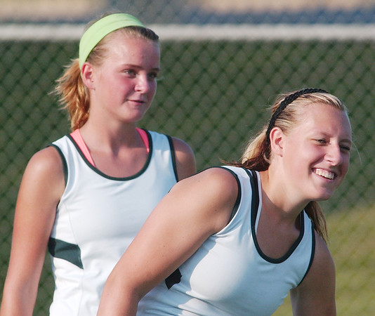 WARREN DILLAWAY / Star Beacon<br /> ASHLEY GRAN of Lakeside (left) enjoys a laugh with first doubles partner Courtney Smith  Thursday during a first doubles home match with Jefferson.