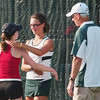 WARREN DILLAWAY / Star Beacon<br /> KATIE ALLEN (facing) of Lakeside prepares to hug Jefferson's Megan Cowling after Cowling had to forfeit their first singles match after a hip injury Thursday afternoon at Lakeside with Lakeside coach Bob Walters watching.