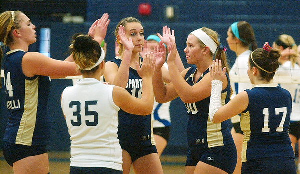 WARREN DILLAWAY / Star Beacon<br /> MEMBERS OF the Conneaut volleyball team (from left) Angie Zappitelli, Lydia Coccitto (35), Lexi Zappitelli (16), tori Simek (00) and Emilee Bucci Tuesday night during a home match with Madison.