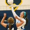 WARREN DILLAWAY / Star Beacon<br /> HALEY HAKE of Madison spikes the ball as Conneaut's Angie Zappitelli prepares to respond Tuesday night at Conneaut's Garcia Gymnasium.