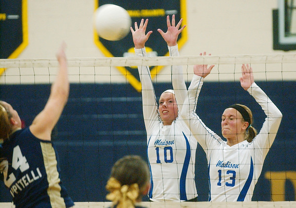 WARREN DILLAWAY / Star Beacon<br /> HALEY AZBILL (10) and Madison teammate Riley Riehl leap for a block of a spike by Conneaut's Angie Zappitelli Tuesday at Conneaut's Garcia Gymnasium.