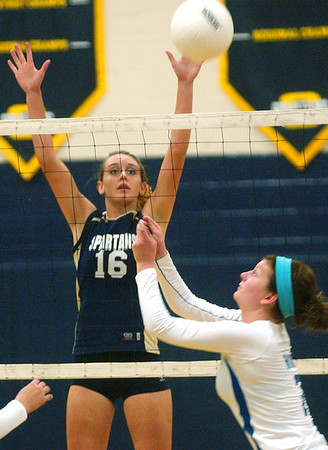 WARREN DILLAWAY / Star Beacon<br /> ASHLEY HIXON (7) of Madison sets the ball as Conneaut's Lexi Zappitelli (16) leaps in the air Tuesday during a match at Conneaut's Garcia Gymnasium.