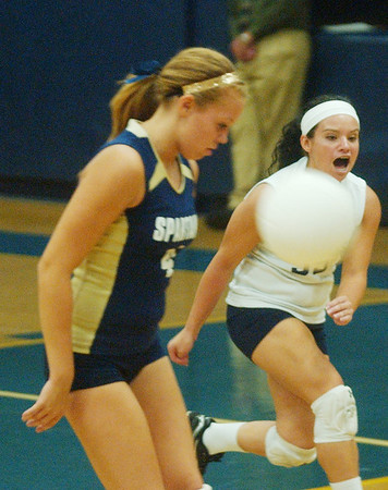 WARREN DILLAWAY / sta rBeacon<br /> LYDIA COCCITTO (right) of Conneaut warns teammate Dani Heinonen that the ball was headed for out of bounds Tuesday night at Conneaut's Garcia Gymnasium.