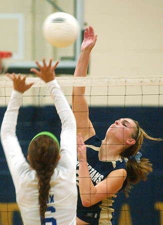 WARREN DILLAWAY / Star Beacon<br /> ANGIE ZAPPITELLI (facing) of Conneaut prepares to spike as Madison's Emily Cox leaps for a block Tuesday night at Conneaut's Garcia Gymnasium.