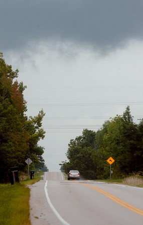 WARREN DILLAWAY / Star Beacon<br /> STORM CLOUDS gather over Route 84 in Kingsville Township Tuesday afternoon.
