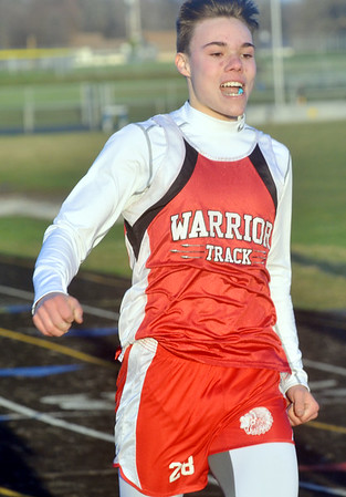 WARREN DILLAWAY / Star Beacon<br /> KENNY CHROMIK of Edgewood wins the 100 meter dash on Friday night at the Grand Valley Twi-Light Invitational.