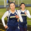 WARREN DILLAWAY / Star Beacon<br /> TAYLOR GRITZER (left) wins the 100 meter dash with Conneaut teammate Taylor Manning close behind on Friday evening at the Grand Valley Twi-Light Invitational in Orwell.