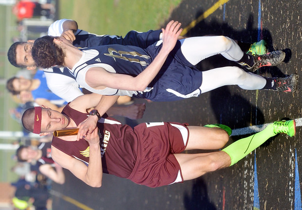 WARREN DILLAWAY / Star Beacon<br /> CORRY MIENTKIEWICZ of Pymatuning Valley eludes other competitors during the 4 x 800 meter relay at the Grand Valley Twi-Light Invitational in Orwell on Friday night.