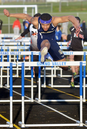 WARREN DILLAWAY / Star Beacon<br /> LEVI STEWART of Conneaut clears the final hurdle on his way to victory in the 110 meter hurdles at the Grand Valley Twi-Light Invitational on Friday evening in Orwell.