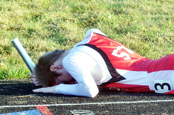 WARREN DILLAWAY / Star Beacon<br /> RYDER SIMMONS of Edgewood recovers after a sprint to the finish during the 4 x 800 meter relay at the Grand Valley Twi-Light Invitational in Orwell on Friday night.