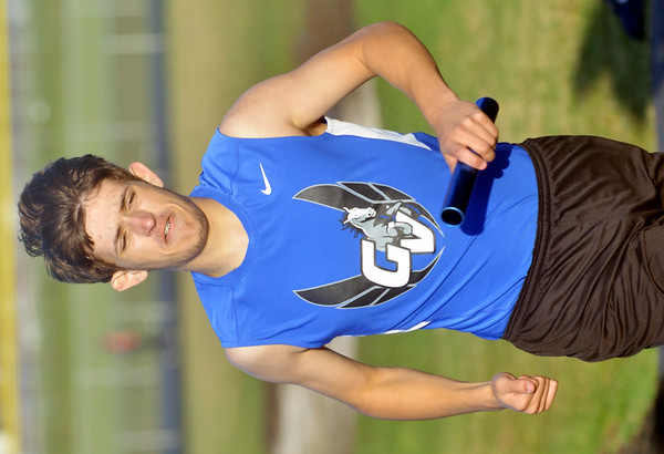 WARREN DILLAWAY / Star Beacon<br /> RYAN GRIFF of Grand Valley a leg of the 4 x 800 meter relay at the Grand Valley Twi-Light Invitational in Orwell.