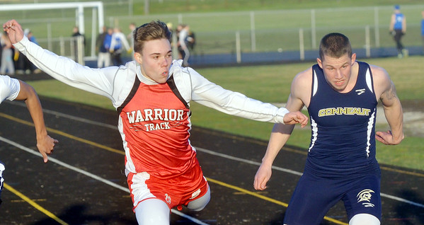 WARREN DILLAWAY / Star Beacon<br /> KENNY CHROMIK of Edgewood (left) wins the 100 meter dash on a lean with Tommy Manning on Friday evening at the Grand Valley Twi-Light Invitational in Orwell.