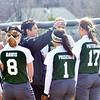 WARREN DILLAWAY / Star Beacon<br /> JODI CANDELLA,  Lakeside softball coach, gathers her team between innings on Saturday during a game at Grand Valley.