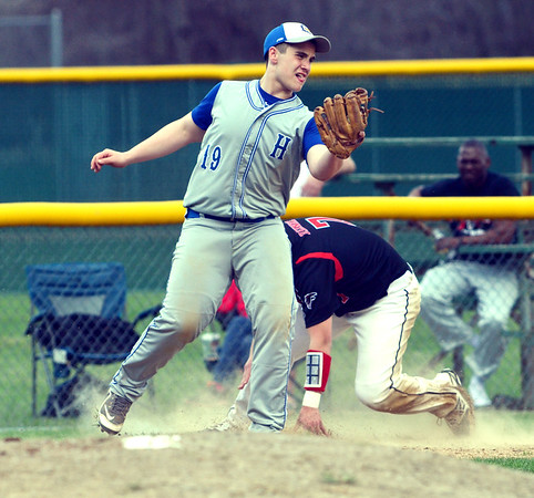 WARREN DILLAWAY / Star Beacon<br /> BRANDON REINKE of Jefferson arrives safely at second base as Hubbard third baseman                  grabs the throw on Monday at Jefferson's Havens   Complex.