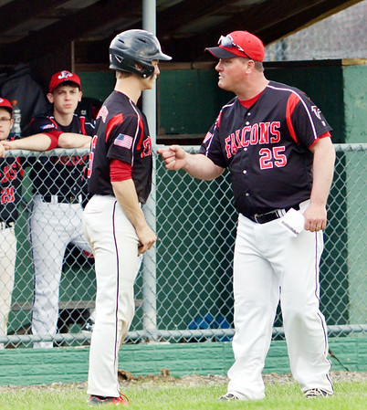WARREN DILLAWAY / Star Beacon<br /> SCOTT BARBER, Jefferson baseball coach, talks with Tyler Maylish on Monday during a home game with Hudson.