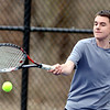WARREN DILLAWAY / Star Beacon<br /> COREY PILTZ of Edgewood returns a shot on Thursday during a third singles match at St. John's Nassief  Courts in Saybrook Township.