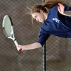 WARREN DILLAWAY / Star Beacon<br /> JESSIE DISALVATORE of St. John serves on Thursday afternoon during a home match at Nassief Courts in    Saybrook Townshiip during a second singles match with James Kukko of Edgewood.