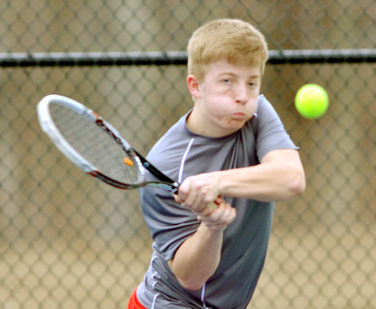 WARREN DILLAWAY / Star Beacon<br /> JAMES KUKKO of Edgewood returns a shot on Thursday during a second singles match at St. John's Nassief  Courts in Saybrook Township.